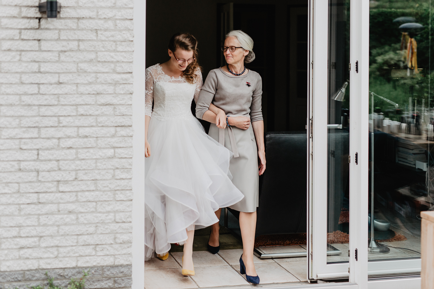 bride walking with mother